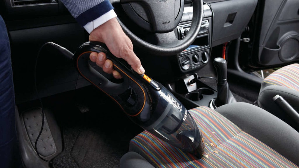 MiniVac in de auto, in gebruik