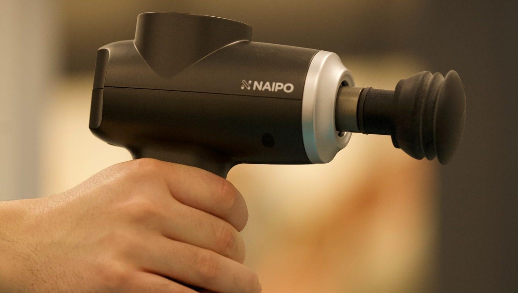 massage gun in hand